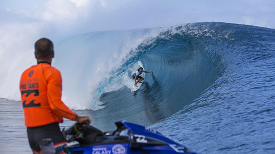 The Tahitian Water Patrol on stand by. Matt Wilkinson in the tube.