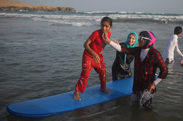 "surfer easkey britton teaching an iranian girl to surf in the film ""into the sea"""