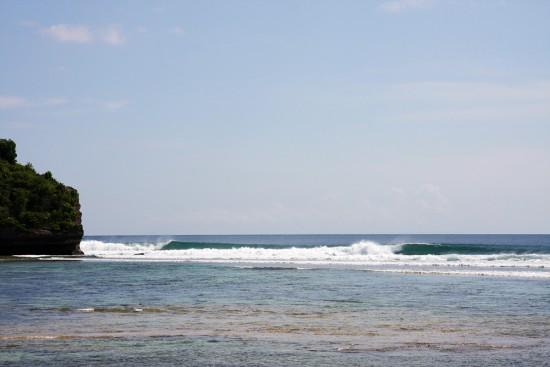 perfect waves breaking at belangan on bali's bukit peninsula