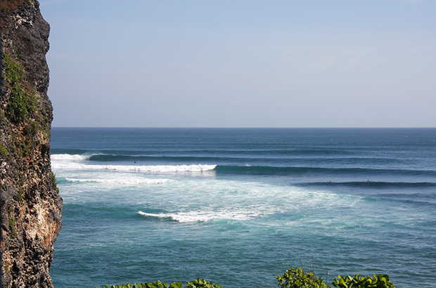 perfect waves breaking at uluwatu on bali's bukit peninsula