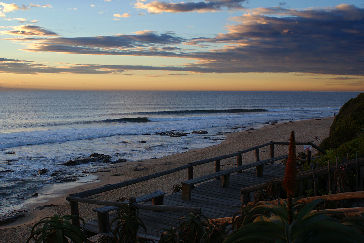 small waves breaking down the point at J-Bay in South Africa