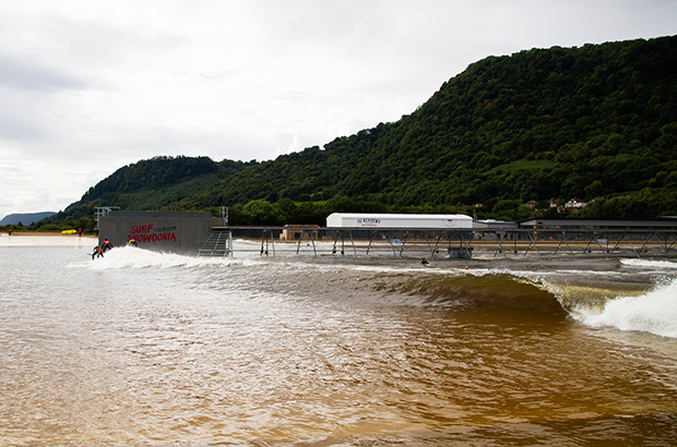an intermediate wave peels along close to the shoreline at surf snowdonia