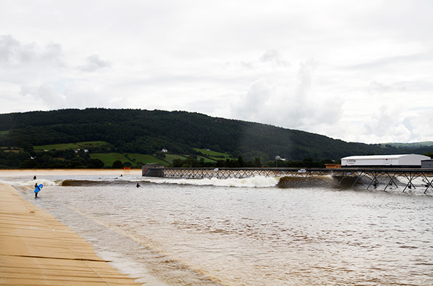 left hand intermediate and advanced waves breaking at the surf snowdonia wavegarden lagoon in wales