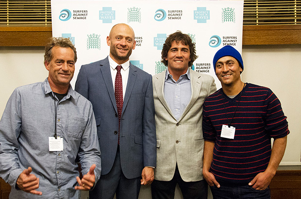 global wave conference organiser hugo tagholm of surfers aggainst sewage with conference vip's tom current, greg long and ramon navarro at the houses of parliament in london, england