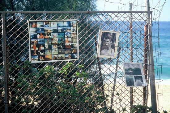 fence covered in memorial images at ehukai beach pipe near pipeline