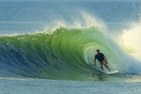 surfrider ceo dr chad nelson in the barrel at a mexican pointbreak, photographed by tom carey