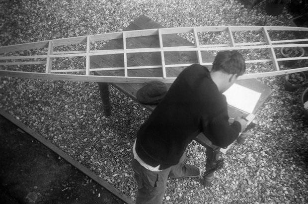 aerial photograph of the construction of the framework of a twelve foot hollow wooden cigar box surfboard