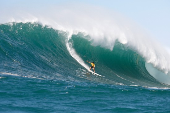 greg long surfing a big wave in the 2009 quiksilver in memory of eddie aikau contest at waimea bay