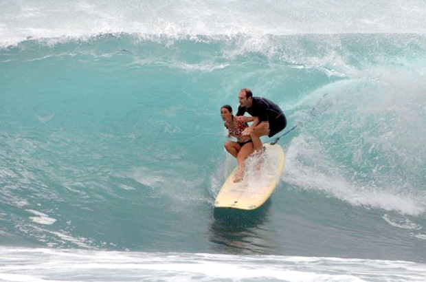 fred and lily branger tandem surfing along a barrelling wave