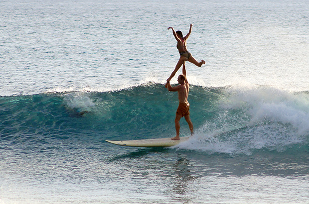 fred and lily branger performing an attitude lift whilst tandem surfing