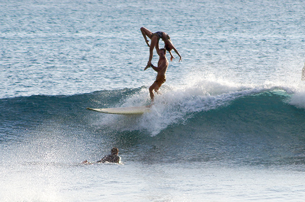 fred and lily branger performing a one arm back lift whilst tandem surfing
