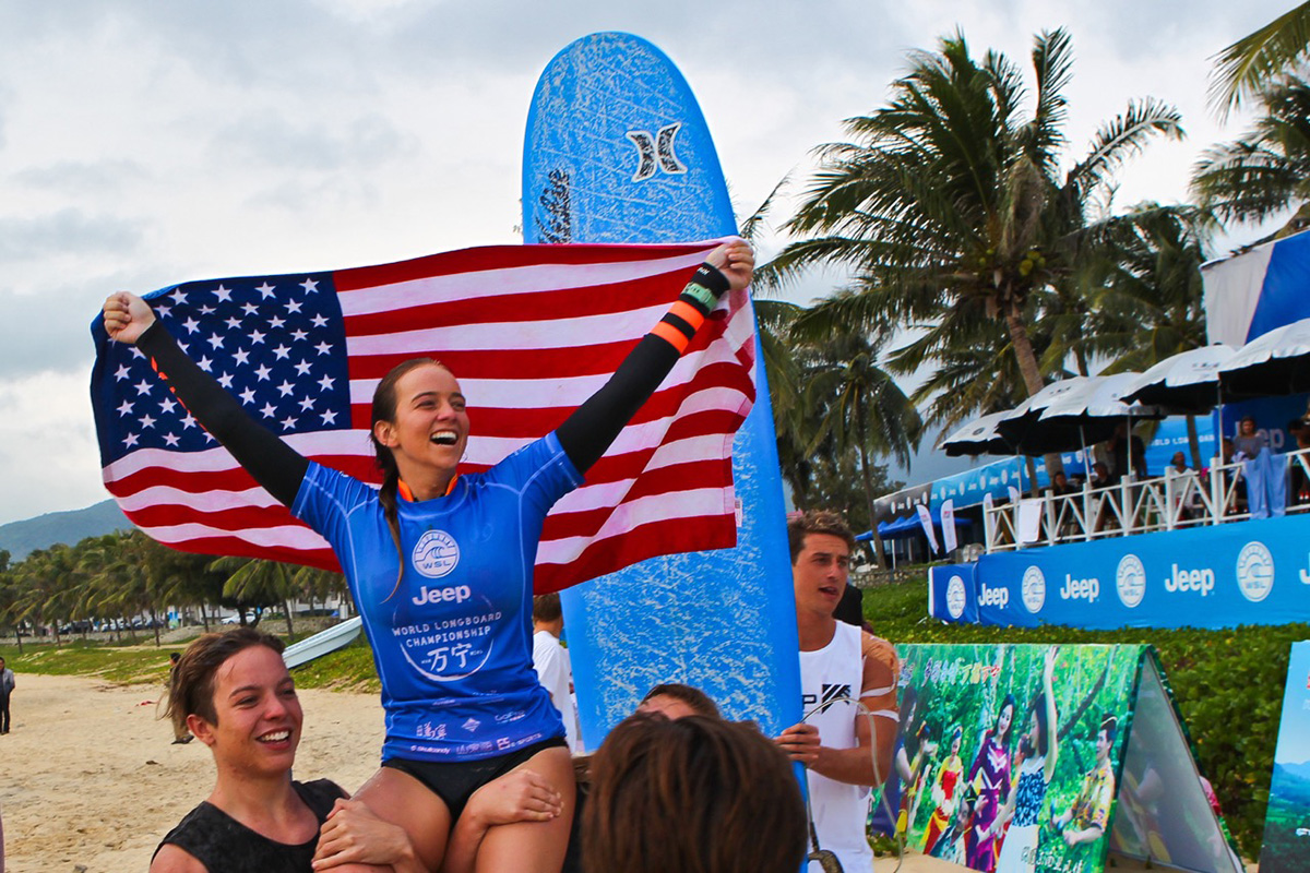 2016 womens world longboard surfing champion rachael tilly with american flag after winning the world title in china
