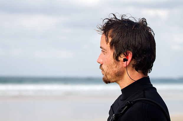 surfer wearing ear plugs