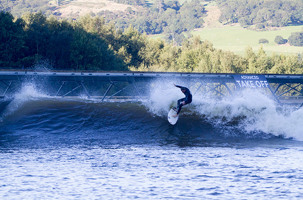 surfer riding a wave at surf snowdonia wave pool in wales