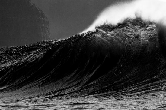 black and white image of a breaking wave in ireland photographed by chris mcclean for the cover of cj mirra album static