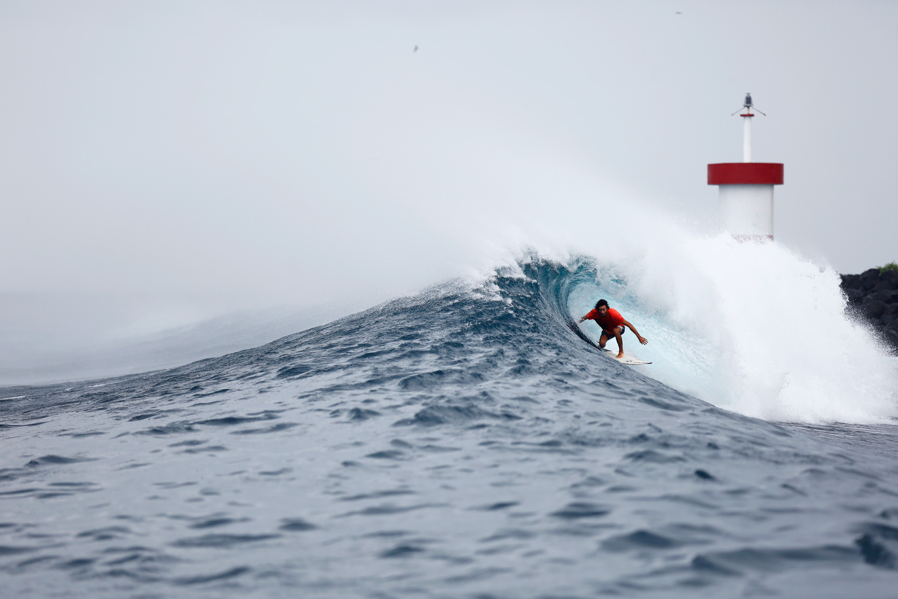 surfer toto idrovo surfing in the galapagos islands photographed by adrien vazques