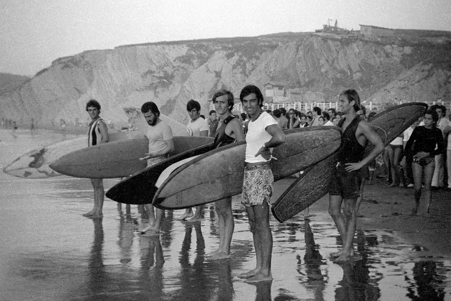 vintage photograph of a group of surfers at one of the first surf contests in spain