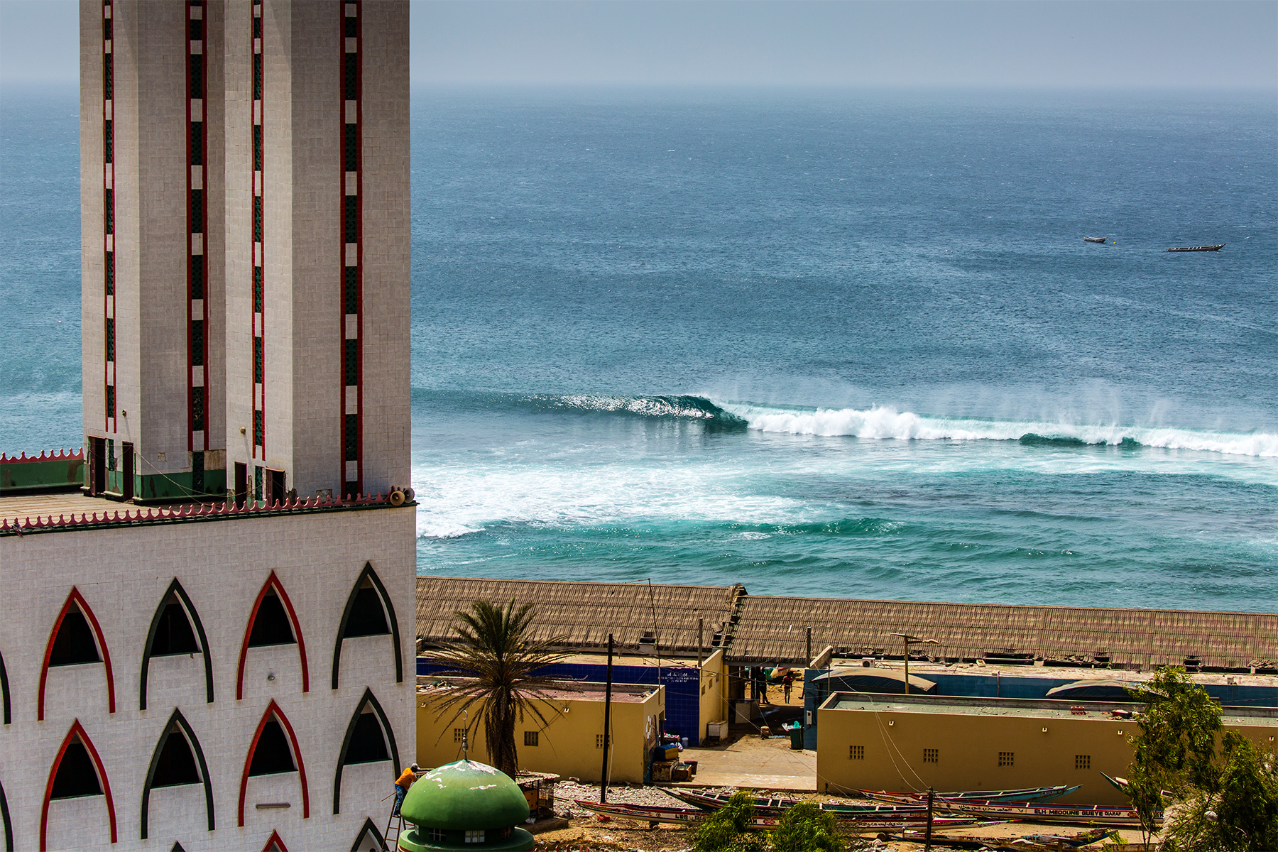 a wave braking at Ouakam in front of the mosque, dakar, senegal. photographed by Andy Grainger