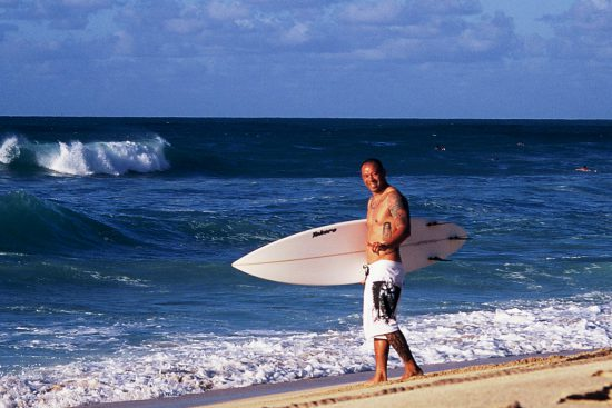 hawaiian surfer sunny garcia about to paddle out at banzai pipeline, north shore, oahu