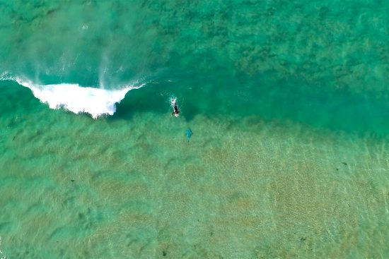 aerial view from project airship shark spotting blimp of a surfer and a shark analogue used for testing