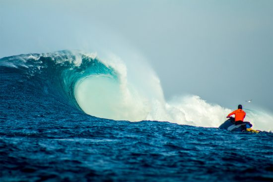 a huge breaking wave at isla todos santos, with a jet ski in the foreground. photographed by jesus salazar