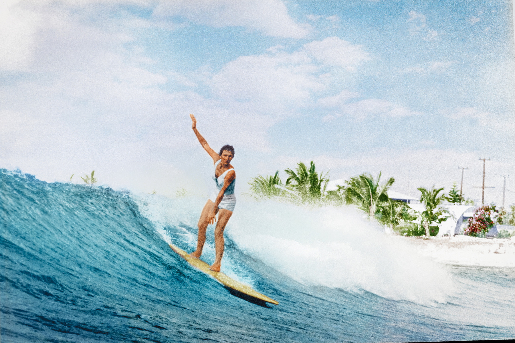 Betty Heldreich surfing Makaha from the cover of water woman book